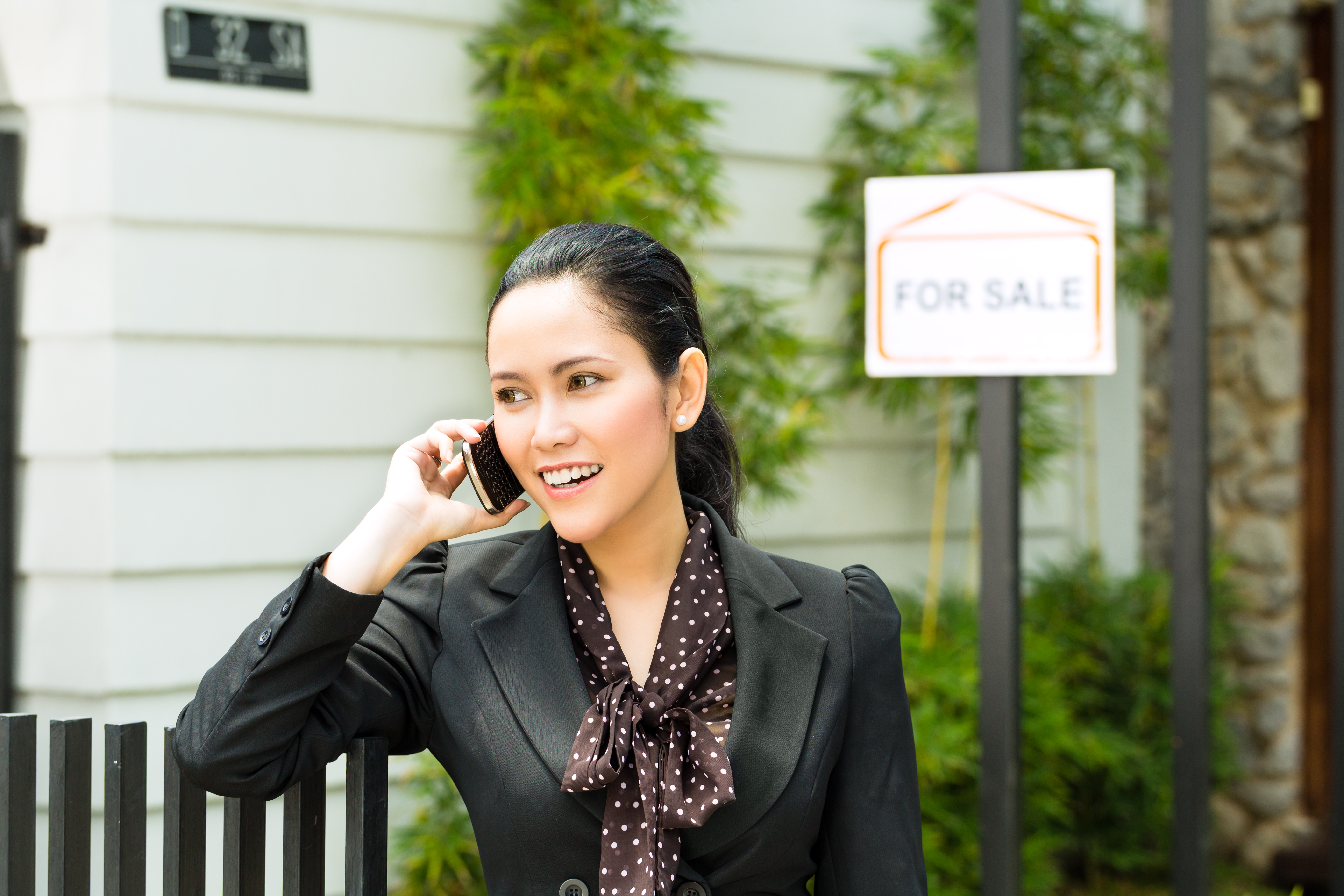 Asian Realtor Presenting A New Home