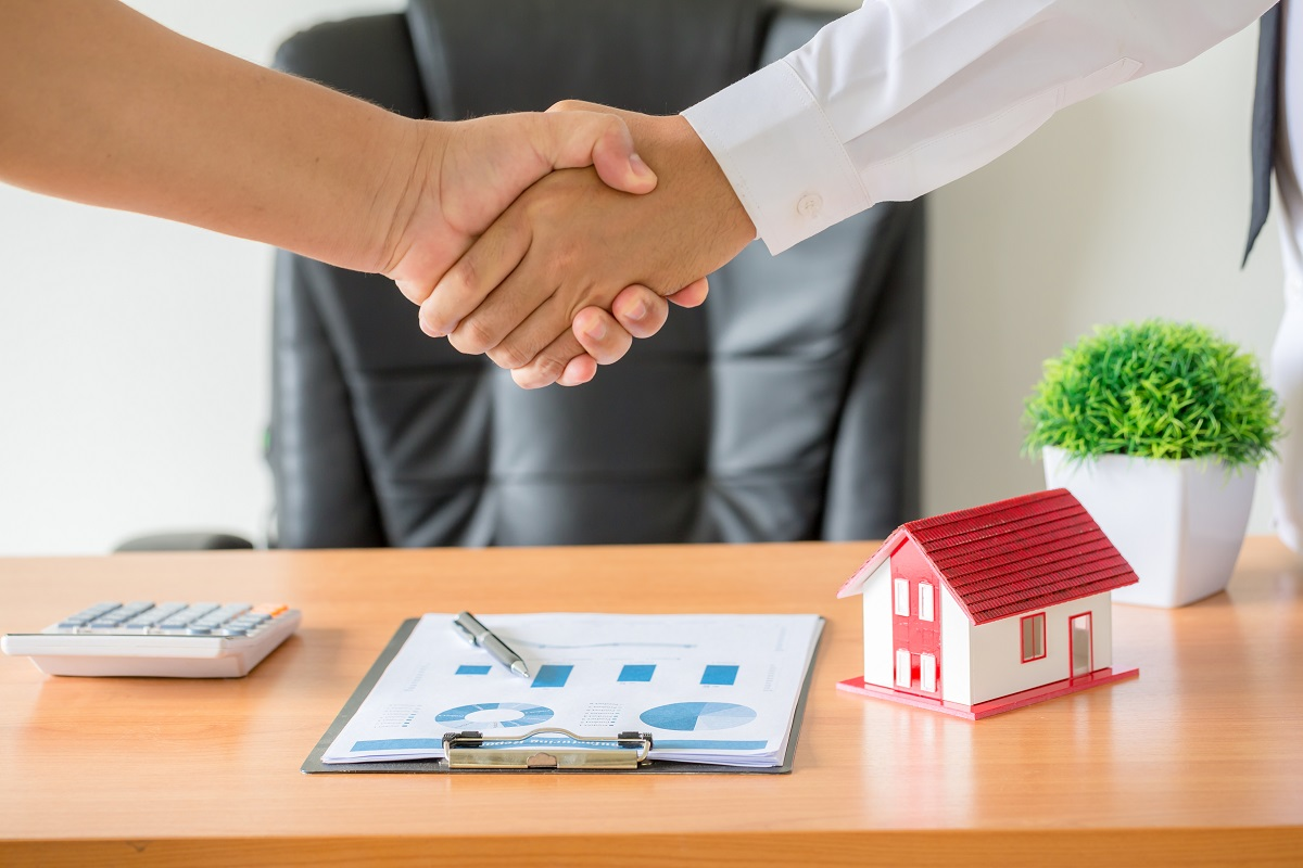 Hands Of Agent And Client Shaking Hands After Signed Contract Bu