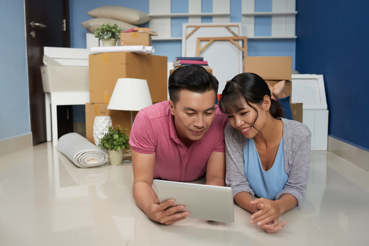 Couple Resting In New Apartment