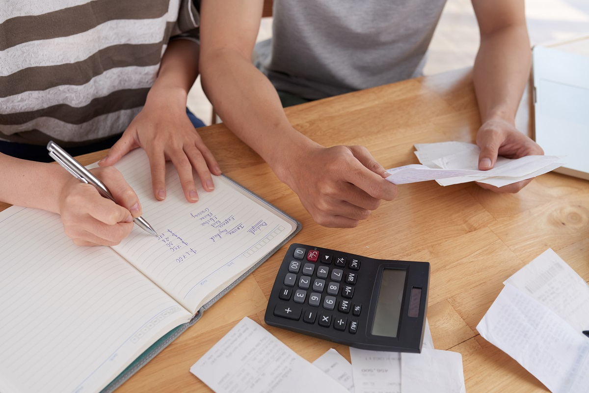 Family Keeping Records Of Expenses