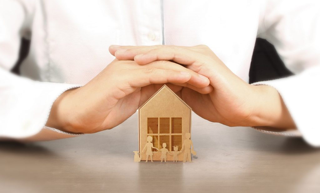 Wooden Toy House. Mortgage Property Home Concept. Buying House