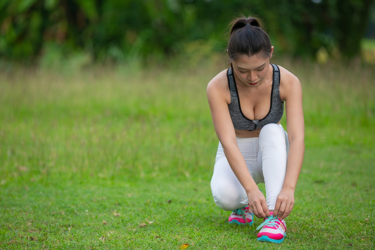 A Beautiful Woman Preparing To Exercise In The Park.
