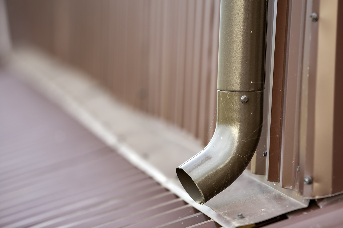 Close Up Of Brown New Gutter Metal System Pipe On Wall. Drain Pr