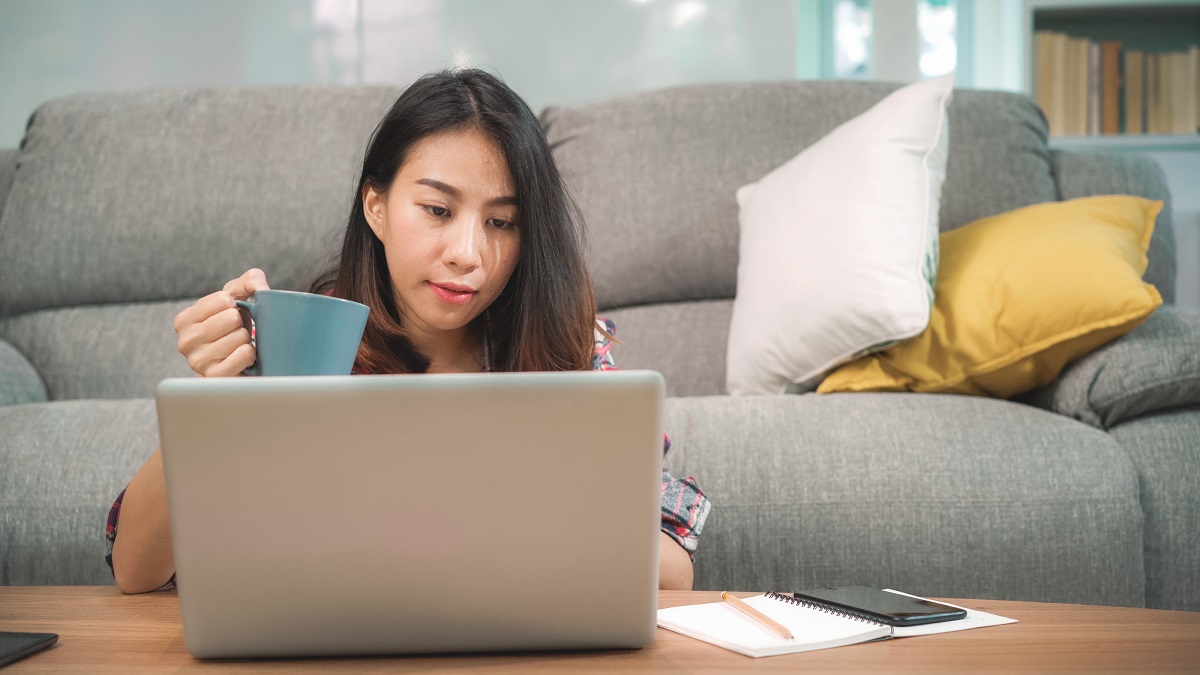 Young Business Freelance Asian Woman Working On Laptop Checking