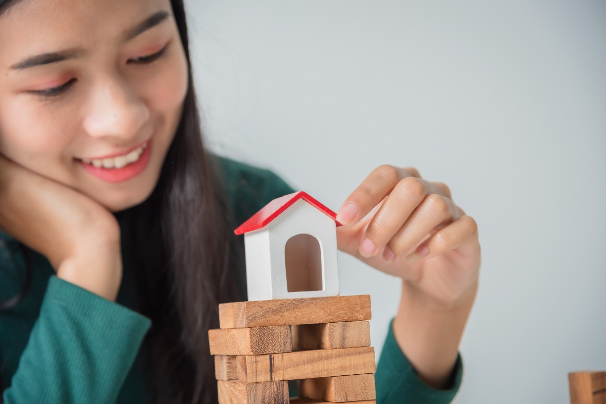 Young Asian Business Woman With Small House, Grow Up Business So