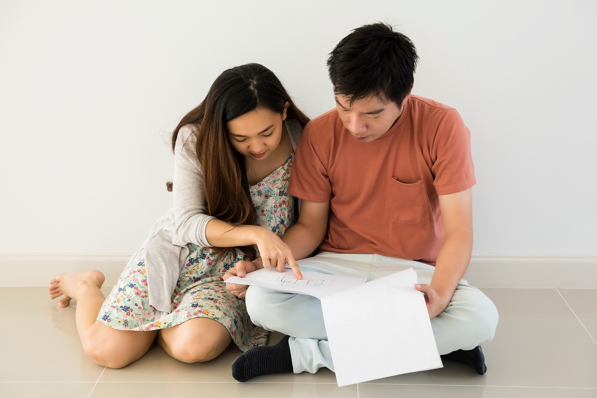 Couple Read Blueprint For Interior Plan