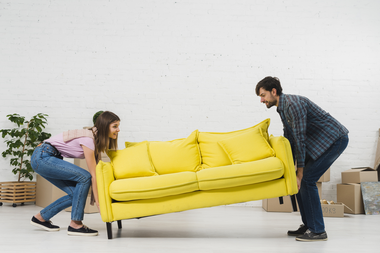 A couple arranging their furniture