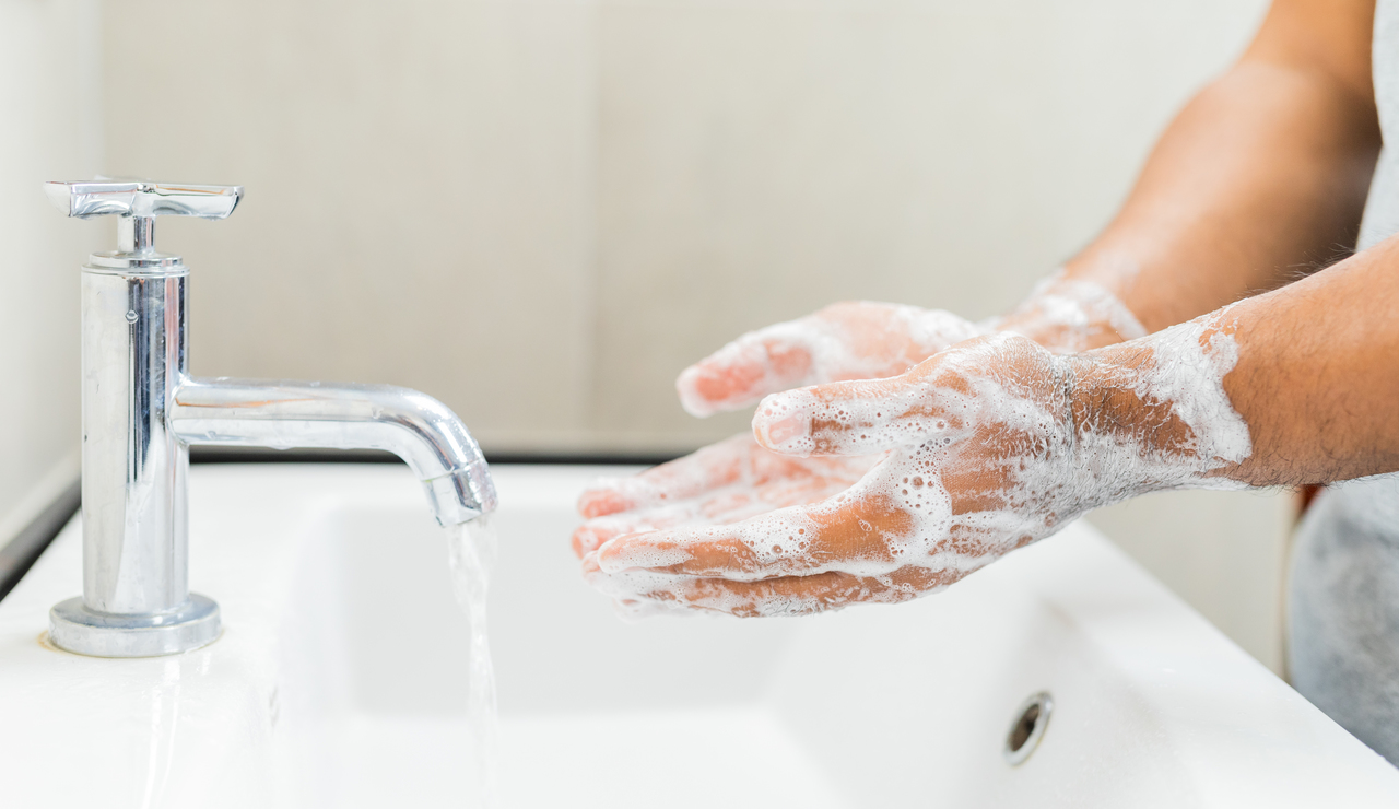 A man washing his hands properly