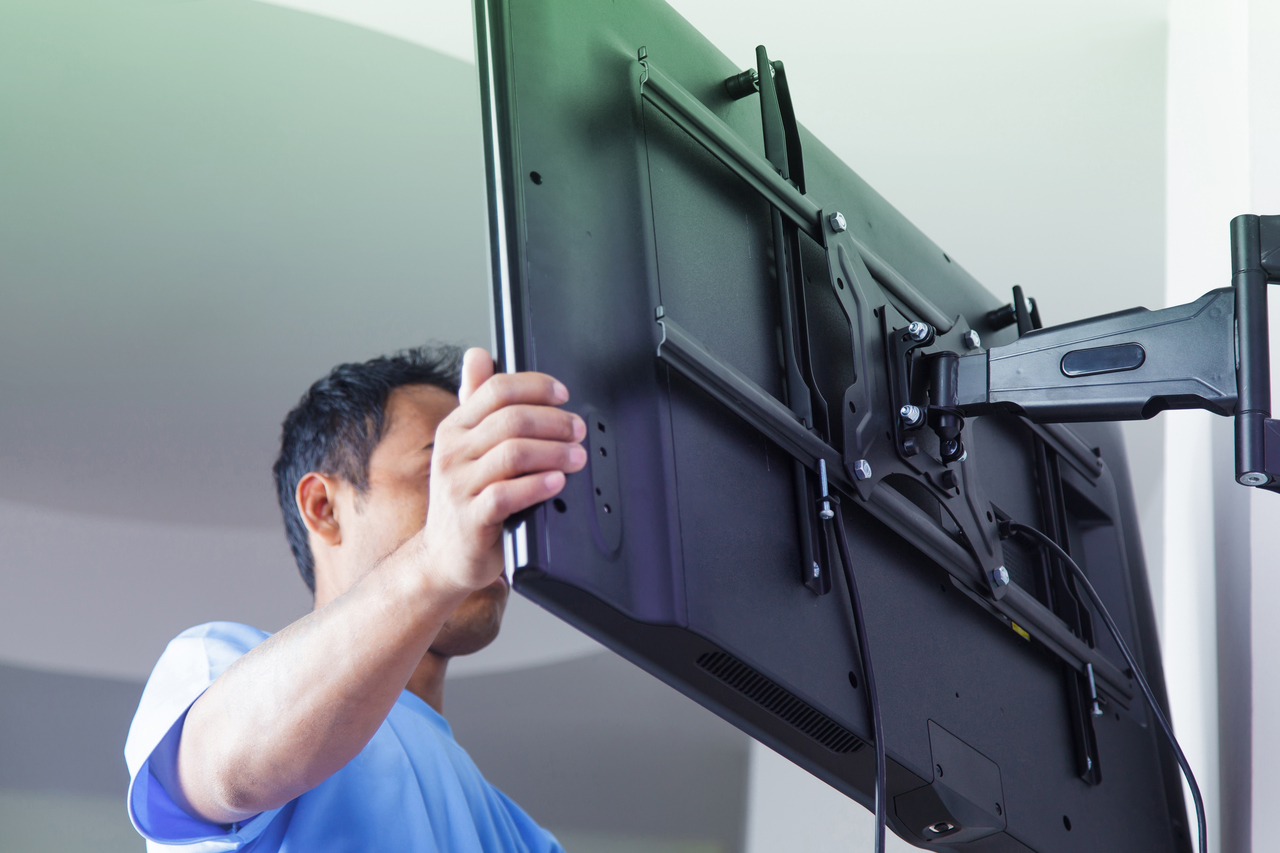 A man mounting a television