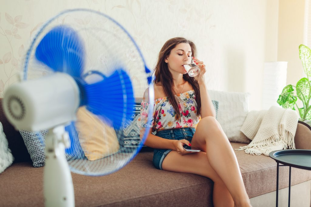 A woman cooling off in her living room