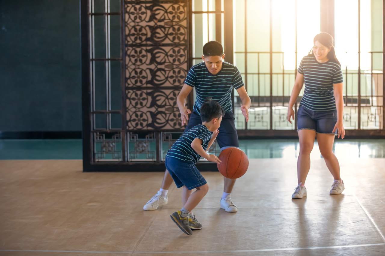 An Asian family playing basketball