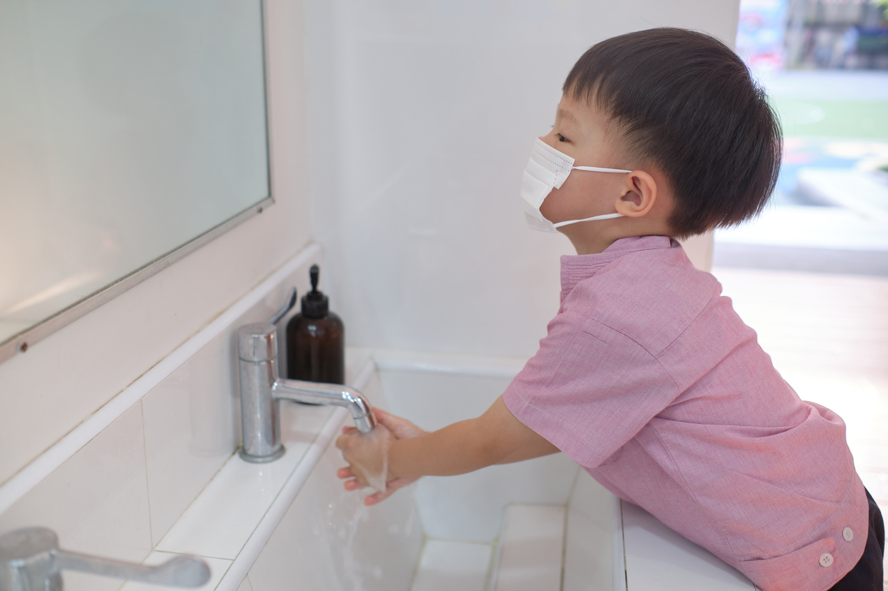 A child washing his hands